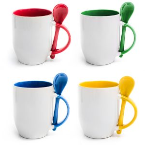 Set of colored cups with spoon isolated on a white background