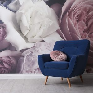 Comfortable armchair near wall with floral wallpaper, space for