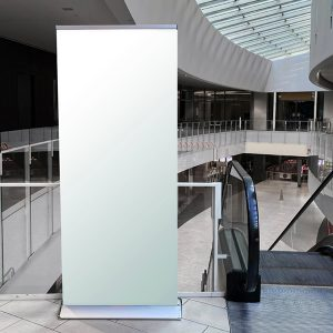 Blank Vertical Roll up banner mockup in a commercial lobby conte