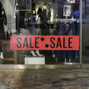 A shop front display. Sale advertisement at a clothing store.