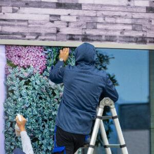 Workers installing window film outdoor